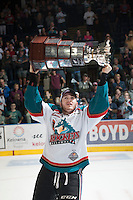 KELOWNA, CANADA - MAY 13: Riley Stadel #3 of Kelowna Rockets skates with the WHL Championship trophy on May 13, 2015 during game 4 of the WHL final series at Prospera Place in Kelowna, British Columbia, Canada.  (Photo by Marissa Baecker/Shoot the Breeze)  *** Local Caption *** Riley Stadel;