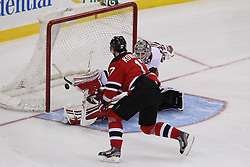 Mar 27; Newark, NJ, USA; Chicago Blackhawks goalie Corey Crawford (50) makes a save on New Jersey Devils left wing Ilya Kovalchuk (17)  during the overtime shootout at the Prudential Center. The Devils defeated the Blackhawks 2-1.