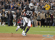 Sep 10, 2018; Oakland, CA, USA; Oakland Raiders tight end Jared Cook (87) carries the ball on a 45-yard reception against the Los Angeles Rams in the first quarter at the Oakland-Alameda County Coliseum. The Rams defeated the Raiders 33-13.