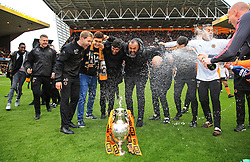 Free to use courtesy of Sky Bet - Wolverhampton Wanderers manager Nuno and coaching staff celebrate after lifting the Sky Bet Championship 2017/18 league trophy - Mandatory by-line: Matt McNulty/JMP - 28/04/2018 - FOOTBALL - Molineux - Wolverhampton, England - Wolverhampton Wanderers v Sheffield Wednesday - Sky Bet Championship