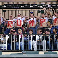Supporters lift their shirts in the upper bleachers ahead of Donald Trump's scheduled speech prior to a rally for the US presidential campaign in Tampa, Florida, America - 12  Feb 2016