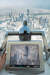 Electronic video telescope screen viewing landscape of Dubai from At The Top observation deck in Burj Khalifa tower in Dubai United Arab Emirates
