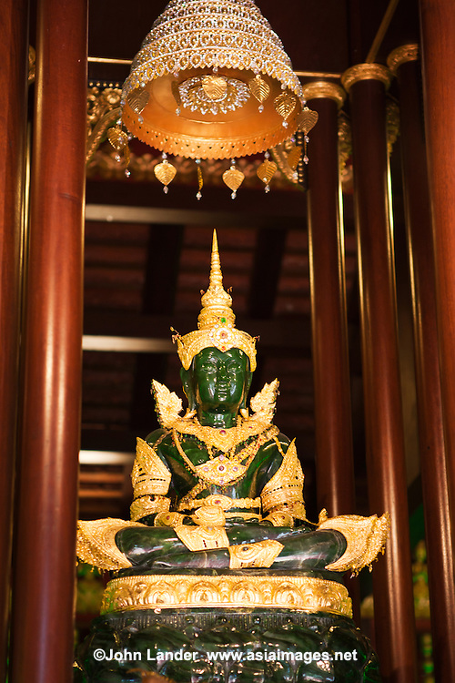 Phra Kaew Marakot Buddha Image at Wat Phra Kaew.  In 1434 after its chedi was struck by lightning revealing the Phra Kaew Marakot Buddha within. Now a replica Phra Kaew Marakot image, carved in China of Canadian jade, stands within the temple today.