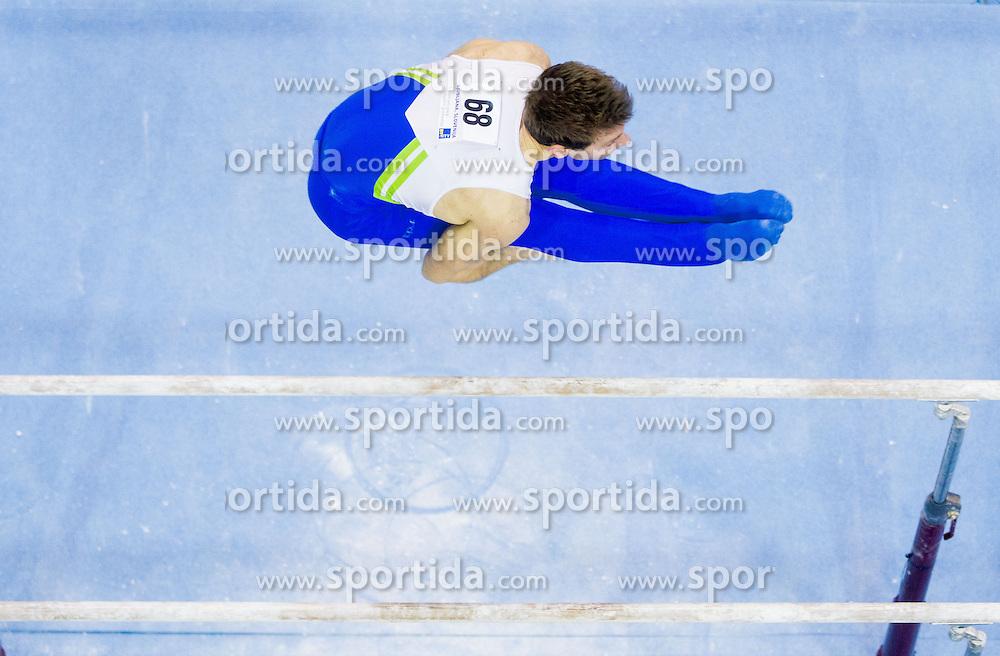 Mitja Petkovsek of Slovenia competes in the Parallel Bars during Final day 2 of Artistic Gymnastics World Cup Ljubljana, on April 27, 2013, in Hala Tivoli, Ljubljana, Slovenia. (Photo By Vid Ponikvar / Sportida.com)
