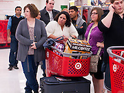 "25 NOVEMBER 2011 - PHOENIX, AZ:  01:25  L to R: Kelly Lloyd (CQ), from Phoenix, Oat Craig (CQ) from Maricopa and her daughter Samanth Craig (CQ) also from Maricopa, wait in line to check out in the Target Store across the street from Paradise Valley Mall Friday morning. ""Black Friday,"" the unofficial start of the holiday shopping season started even earlier than normal. Many stores, including Target and Best Buy, opened at midnight.    Photo by Jack Kurtz"