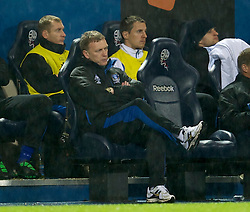 BOLTON, ENGLAND - Sunday, February 13, 2011: Everton's manager David Moyes looks dejected as his side lose 2-0 to Bolton Wanderers during the Premiership match at the Reebok Stadium. (Photo by David Rawcliffe/Propaganda)