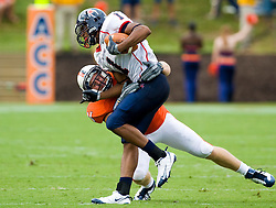 Richmond wide receiver Kevin Grayson (1) is tackled by Virginia linebacker Jon Copper (54) after a pass reception.  The Virginia Cavaliers defeated the #3 ranked (NCAA Division 1 Football Championship Subdivision) Richmond Spiders 16-0 in a NCAA football game held at Scott Stadium on the Grounds of the University of Virginia in Charlottesville, VA on September 6, 2008.