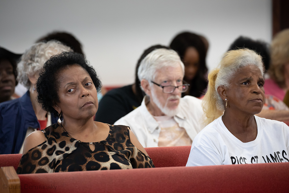 Sharon Lavinge next to Gail LeBeouf  at a meeting on July 2 in Convent, in St. James Parish District 4 where WIlma Subra explained the crisis at the Mosiac Plant.