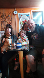 EXCLUSIVE: An Australian man has created his own Outback outpost 11,000 miles from home on the Shetland Islands – and he even has WALLABIES. Tasmanian Dave Kok, 42, has built his own Aussie oasis on the Scottish archipelago after deciding to settle there when he was travelling Europe. Now Dave lives with his Shetland native wife Louise, 38, and two daughters Caitlin, 11, and Ruby, aged four. Social care worker Dave came to the islands in the late 90s and since 2016 has been building his own watering hole choc-full of Australiana on the island of Burra. Dave's place 'The Outpost' is a renovated wooden porta cabin filled with Tasmanian beers, Tim Tams, books on bush craft and Aussie Rules sporting memorabilia. Locals use the Outpost as their local bar and meeting place, as the nearest pub or café is three bridges and three islands away. And visitors can now enjoy the Outpost's wallabies Ned and Kelly who David brought to the island this winter. Based on the Shetland Islands latitude the marsupials could be the most northerly of their species anywhere on the planet. Dave said visiting Australians are often surprised to find the antipodean paradise in such a remote location. 16 Feb 2018 Pictured: Pic from Dave Kok/Magnus News Agency. Pic shows Dave Kok, with his wife Louise, 38, daughter Caitlin, 11, and Ruby, 4, and Toffee the dog aged four. An Australian man has created his own Outback outpost 11,000 miles from home on the Shetland Islands – and he even has WALLABIES. Tasmanian David Kok, 42, has built his own Aussie oasis on the Scottish archipelago after deciding to settle there when he was travelling Europe. Now David lives with his Shetland native wife Louise and two daughters Caitlin, 11, and Ruby, aged four. Social care worker David came to the islands in the late 90s and has built his own watering hole choc-full of Australiana on the island of Burra. David's place 'The Outpost' is a renovated wooden porta cabin filled with Tasmanian beers, Ti