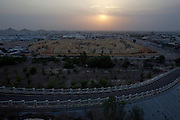 Sunset view from Al Nagfa Mountain. Etisalat Bulding (r., with ball on top), new appartment houses.