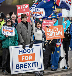 © Licensed to London News Pictures. 14/01/2019. London, UK. Pro- and anti-Brexit protesters wait at Carriage Gate for Prime Minister Theresa May to arrive at Parliament where she is due to update MPs on Brexit. MPs will vote on her proposed Brexit deal tomorrow. Photo credit: Rob Pinney/LNP