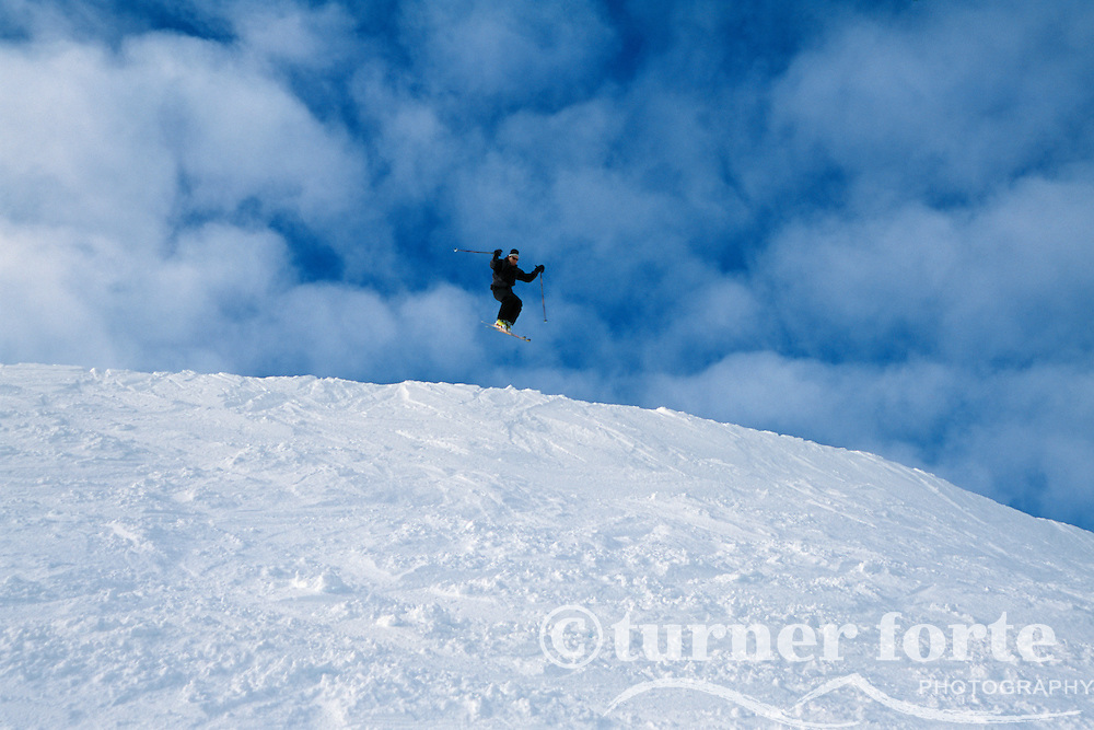 Catching air while skiing Alpine Meadows, Lake Tahoe, California