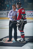 KELOWNA, CANADA - NOVEMBER 1:  Myles Bell #29 of the Kelowna Rockets accepts an award from McDermots at the beginning of the game against the Kamloops Blazers at the Kelowna Rockets on November 1, 2012 at Prospera Place in Kelowna, British Columbia, Canada (Photo by Marissa Baecker/Shoot the Breeze) *** Local Caption ***