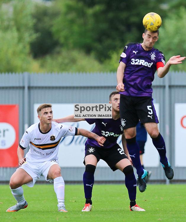 Rangers Captian Lee Wallace clears tjhe danger during the Dumbarton FC v Rangers FC Scottish Championship 19th September 2015 <br /> <br /> (c) Andy Scott | SportPix.org.uk