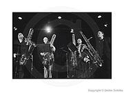 """23.10.2012, DEU, Berlin: Deep Schrott, Bass-Saxophon-Quartett, vlnr.: Dirk Raulf spielt u.a. Conn """"Ladyface"""" Bass-Saxophon (1935), Andreas Kaling spielt u.a. Conn 14M Bass-Saxophon (1928), Jan Klare spielt u.a. Conn Bass-Saxophon, Wollie Kaiser spielt u.a. Keilwerth Bass-Saxophon , Das einzige Bass-Saxophon-Quartett des Universums, """"Deep Schrott Plays Dylan & Eisler"""" Deutschland, Haus der Berliner Festspiele, Berlin-Wilmersdorf, SCHILKE_2012102321043490 [ Photo-copyright: Detlev Schilke, Postfach 350802, 10217 Berlin, Germany, Mobile: +49 (0)170 3110119, photo@detschilke.de, Postbank Berlin, Kto.: 970 880 101, BLZ: 100 100 10, IBAN: DE08 1001 0010 0970 8801 01, BIC: PBNKDEFF, VAT-No./USt.-ID: DE160478504, www.detschilke.de - Jegliche Nutzung nur gegen Honorar nach MFM, Urhebernachweis nach Par. 13 UrhG und Belegexemplare. Only editorial use, advertising after agreement! Eventuell notwendige Einholung von Rechten Dritter wird nicht zugesichert, falls nicht anders vermerkt. AGB/TERMS: http://www.detschilke.de/terms.html ]"""