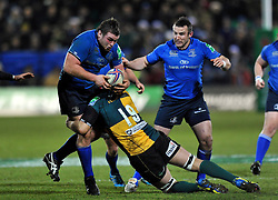 Jack McGrath (Leinster) is tackled by Christian Day (Northampton) - Photo mandatory by-line: Patrick Khachfe/JMP - Tel: Mobile: 07966 386802 07/12/2013 - SPORT - RUGBY UNION -  Franklin's Gardens, Northampton - Northampton Saints v Leinster - Heineken Cup.