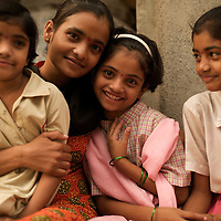 At home Vasanti and daughters Shrudha, 10 (HIV positive, in pink), Shubhada, 11 (HIV negative, right) and Vrinda, 8 (status not known). Vasanti Shinde, 26, works for the Save Foundation. Others neighbours<br />