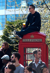 © Licensed to London News Pictures. 21/04/2013. London, UK. A spectator watches the race during the Virgin London Marathon 2013 on April 21, 2013 in London, England. Photo credit : Peter Kollanyi/LNP