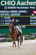 Marcela Krinke Susmeij - Smeyers Lazander<br /> World Equestrian Festival, CHIO Aachen 2013<br /> © DigiShots