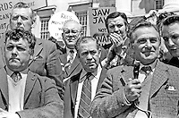 UWC (Ulster Workers Council) Strike. Strike leaders addressing supporters in front of Parliament Building at Stormont, Belfast, N Ireland, UK. Shortly after this protest the Executive resigned. Included in photograph are Rev Ian Paisley (second row, left), Harry Murray (with microphone) and Harry Patterson (centre). Ref: 197405280113<br /> <br /> Copyright Image from Victor Patterson, Belfast, UK<br /> <br /> t: +44 28 9066 1296 (from Rep of Ireland 048 9066 1296)<br /> m: +44 7802 353836<br /> e: victorpattersonbelfast@gmail.com<br /> <br /> www.images4media.com<br /> <br /> Please see my full Terms and Conditions of Use at https://www.images4media.com/p/terms-conditions - it is IMPORTANT that you familiarise yourself with them.<br /> <br /> Images used online incur an additional cost. This cost should be agreed in writing in advance. Online images must be visibly watermarked i.e. © Victor Patterson or that of the named photographer within the body of the image. The original metadata must not be deleted from images used online.<br /> <br /> This image is only available for the use of the download recipient i.e. television station, newspaper, magazine, book publisher, etc, and must not be passed on to a third party. It is also downloaded on condition that each and every usage is notified within 7 days to victorpattersonbelfast@gmail.com.<br /> <br /> The right of Victor Patterson (or the named photographer) to be identified as the author is asserted in accordance with The Copyright Designs And Patents Act (1988). All moral rights are asserted.