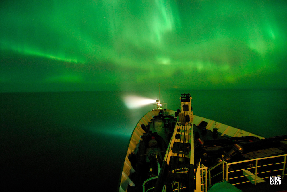 Northern lights or Aurora borealis on the Arctic night sky, viewed from Orlova Russian Icebreaker, High Arctic. Canada<br /> ( night, nocturnal, show, colorful, green, red, spectacule, weather, atmosphere,.