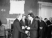 New Government Receive Seals Of Office.   (N84)..1981..30.06.1981..06.30.1981..30th June 1981..The newly elected Fine Gael /Labour coalition government under Dr Garret Fitzgerald received their seals of office from President Hillery at Áras an Uachtaráin today...Mr Jim Mitchell TD is pictured accepting his seal of office as Minister for Justice from President Hillery at the Áras today.