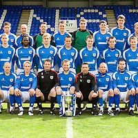St Johnstone FC 2008-09 squad pictured with the Scottish First Division trophy...05.05.09 Back from left, Stuart McCaffrey, Paul Sheerin, Alan Main, Martin Hardie, Euan McLean, Derek Holmes, Kevin James and Steven Anderson.<br /> Miidle row from left, Nick Summersgill (Physio), Jocky Peebles (Asst Physio), Steven Kinniburgh, Collin Samuel. Liam Craig, Steven Milne, Andy Jackson, Kevin Moon, Steven Doris, Chris Millar, Tommy Campbell (Coach) and Atholl Henderson (Coach)<br /> Front row from left, Graham Barrett, Graham Gartland, Gary Irvine, Tony Docherty (Asst Manager), Kevin Rutkiewicz, Derek McInnes (Manager), Jody Morris, Peter MacDonald and Gavin Swankie<br /> Picture by Graeme Hart.<br /> Copyright Perthshire Picture Agency<br /> Tel: 01738 623350  Mobile: 07990 594431