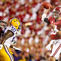 November 3, 2012; Baton Rouge, LA, USA;  Alabama Crimson Tide quarterback AJ McCarron (10) throws as LSU Tigers defensive end Jermauria Rasco (59) pressures during the first quarter of a game at Tiger Stadium.  Mandatory Credit: Derick E. Hingle-US PRESSWIRE