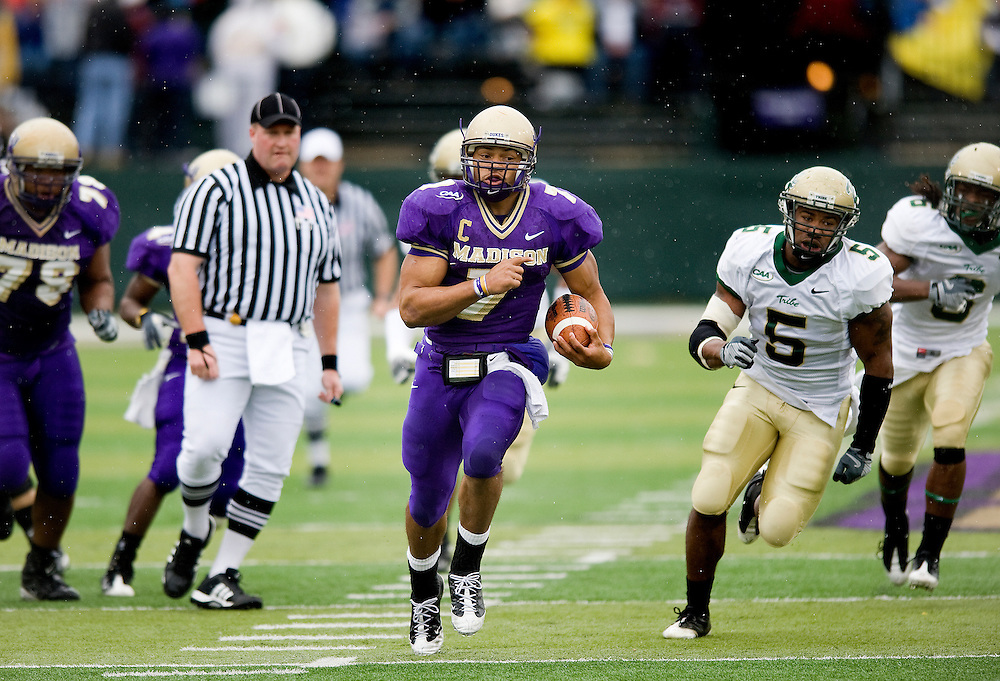 James Madison's Rodney Landers breaks through the William and Mary defense during first quarter action at Bridgeforth Stadium in Harrisonburg Satuday. JMU won the game 48-34.
