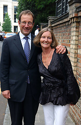 MR & MRS RICHARD DESMOND at Sir David & Lady Carina Frost's annual summer party held in Carlyle Square, Chelsea, London on 5th July 2006.<br />