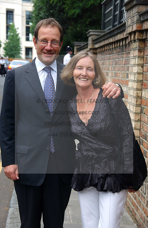MR &amp; MRS RICHARD DESMOND at Sir David &amp; Lady Carina Frost's annual summer party held in Carlyle Square, Chelsea, London on 5th July 2006.<br />