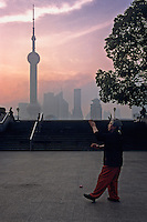 This photograph perfectly illustrates China's generational shift towards modernization as an elderly woman practices the ancient art of Tai Chi with the ultra modern Pudong district in the background.