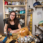 """February 24, 2014 - New York, NY : <br /> Danielle Baskin, founder of Belle Helmets, poses for a portrait in her office/studio space at 115 E. 23rd Street in Manhattan on Monday afternoon, Feb. 24. Danielle hand-paints bicycle helmets, which she sells to clients in New York and across the globe. Her setup includes a 21.5"""" iMac, visible at left, and an iPhone 5S, in foreground at center next to her paints.  <br /> CREDIT: Karsten Moran for Macworld Magazine"""