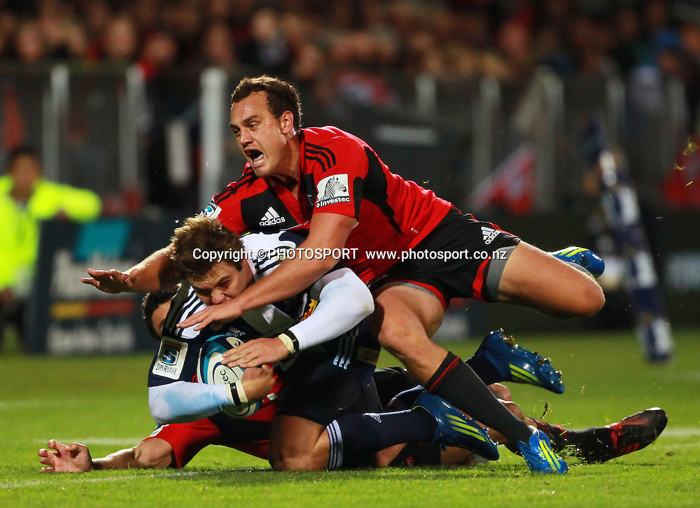 Israel Dagg tackles Stormers winger Gerhard van de Heever with Dan Carter underneath. Super Rugby game between the Crusaders and the Stormers. Crusaders new Christchurch Stadium at Rugby League Park, Saturday 14 April 2012. Photo : Joseph Johnson / photosport.co.nz