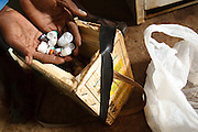 Vaccinator Bala Diakite fills an ice box with vaccines as he prepares to travel to a nearby village for an outreach vaccination sessionat the Kassaro community health center in the village of Kassaro, Mali on Saturday August 28, 2010..