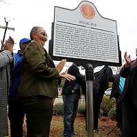 Thomas Wells | BUY at PHOTOS.DJOURNAL.COM<br /> Tupelo City Councilwoman Nettie Davis, center, and Theodore Debro begin to celeberate after unveiling the new marker along North Green Street where many black owned business thrived liked Debro's Father owned Debro's Cafe.