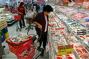 "(KEIKO MATSUDA IS MODEL RELEASED). Grocery store in Yomitan Village, Okinawa, where Keiko Matsuda does some of her shopping. (Supporting image from the project Hungry Planet: What the World Eats.) The Matsuda family of Yomitan Village, Okinawa is one of the thirty families featured, with a weeks' worth of food, in the book Hungry Planet: What the World Eats. Hara hachi bu: ""eat only until 80 percent full,"" say older Okinawans. The island has been the focus in recent years of researchers trying to discover why a disproportionately large number of Okinawans are living to age 100 or more."