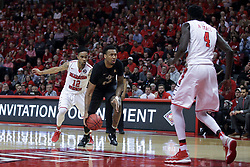 "20 March 2017:  Tony Wills(12) and Daouda ""David"" Ndiaye (4) double up on encroaching  Nick Banyard during a College NIT (National Invitational Tournament) 2nd round mens basketball game between the UCF (University of Central Florida) Knights and Illinois State Redbirds in  Redbird Arena, Normal IL"