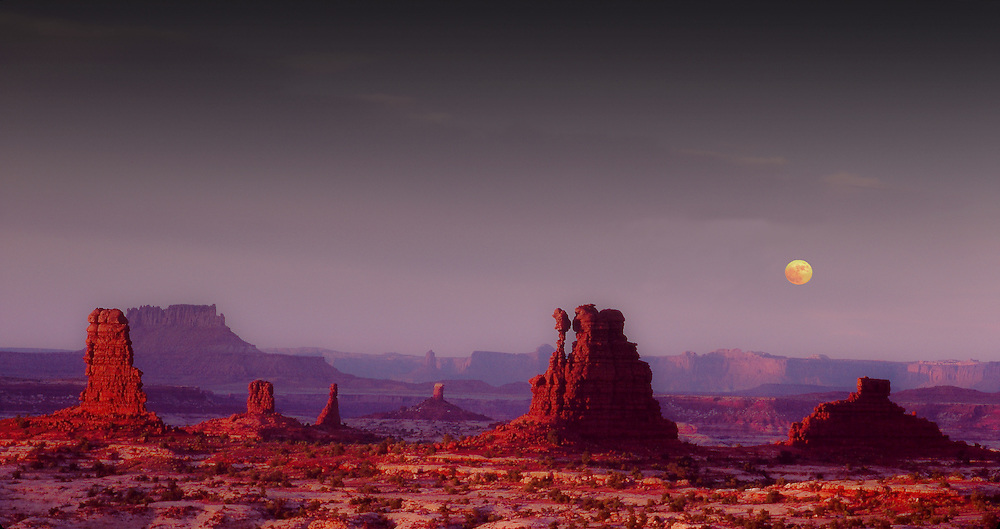 Land Of The Standing Rocks with full moon, Maze District, Canyonlands National Park