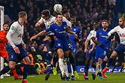 Chelsea defender Cesar Azpilicueta (28) and Tottenham Hotspur midfielder Harry Winks (8) clash in the air during the EFL Cup semi final second leg match between Chelsea and Tottenham Hotspur at Stamford Bridge, London, England on 24 January 2019.