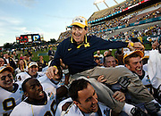 [PHOTO # 11 ]  <br /> <br /> 01 01 2008 - ORLANDO - The Wolverines carry coach Lloyd Carr off the field after a win in his final game as Michigan coach. Michigan defeated Florida 41-35.<br /> <br /> BRIAN CASSELLA | Times<br /> <br /> COLLEGE FOOTBALL - Florida Gators vs Michigan Wolverines in the Capitol One Bowl in Orlando at the Citrus Bowl on Tuesday (1/1/08).