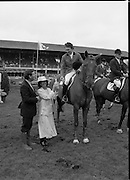 Jameson Whiskey International at the Dublin Horse Show.  (R39).1986..07.08.1986..08.07.1986..7th August 1986..The Jameson Whiskey International at the Dublin Horse Show in the RDS was won by Peter Charles of Great Britain. He rode 'Merrimandias' to victory in the event...Picture shows Mrs Marie Cummins, wife of the Managing Director,Irish Distillers presenting the trophy to Peter Charles on 'Merrimandias'. Mr Michael Cummins also features in the picture.
