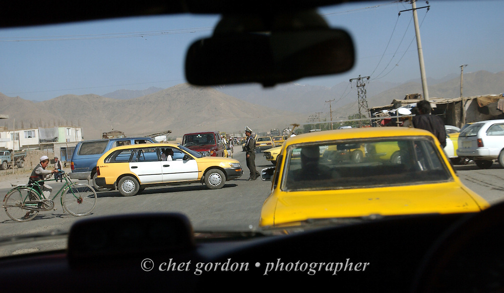 Intersection in morning traffic during a drive through Kabul, Afghanistan on Sunday morning, May 26, 2002.