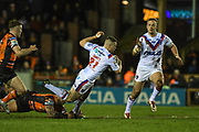 Max Jowitt (21) of Wakefield Trinity is tackled during the Betfred Super League match between Castleford Tigers and Wakefield Trinity Wildcats at the Jungle, Castleford, United Kingdom on 21 February 2020.