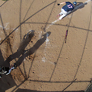 An overhead view of the batters box as a batter runs towards face base after hitting into play during the High School Baseball ball game between Trumbull Golden Eagles and McMahon Senators at Brien McMahon High School. Norwalk, Connecticut. USA. 26th April 2012. Photo Tim Clayton