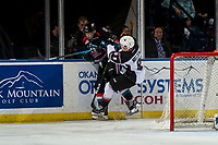 KELOWNA, CANADA - NOVEMBER 28:  Tristen Nielsen #8 of the Vancouver Giants checks Mark Liwiski #9 of the Kelowna Rockets behind the net during second period on November 28, 2018 at Prospera Place in Kelowna, British Columbia, Canada.  (Photo by Marissa Baecker/Shoot the Breeze)