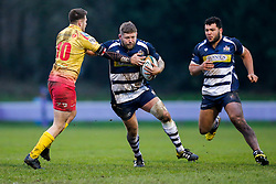 Bristol Rugby Hooker Chris Brooker (capt) is challenged by Scarlets XV Fly-Half Josh Lewis - Mandatory byline: Rogan Thomson/JMP - 17/01/2016 - RUGBY UNION - Clifton Rugby Club - Bristol, England - Scarlets Premiership Select XV v Bristol Rugby - B&I Cup.
