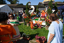 © Licensed to London News Pictures. 02/09/2018. Aldenham, UK. A young boy dressed as Krishna stands next to a floral display at Bhaktivedanta Manor Temple in Aldenham, Hertfordshire during the Janmashtami Hindu festival. Janmashtami is an annual Hindu festival that celebrates the birth of Krishna. Bhaktivedanta Manor, the venue fo the event, was donated to the Hare Krishna movement in February 1973 by former Beatle George Harrison. Photo credit: Ben Cawthra/LNP