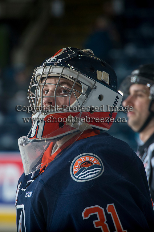 KELOWNA, CANADA - MARCH 25: Dylan Ferguson #31 of the Kamloops Blazers stands at the bench during warm up against the Kelowna Rockets on March 25, 2017 at Prospera Place in Kelowna, British Columbia, Canada.  (Photo by Marissa Baecker/Shoot the Breeze)  *** Local Caption ***