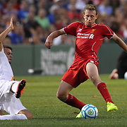 Adem Ljajic, (left), AS Roma, challenges Lucas Leiva, Liverpool, during the Liverpool Vs AS Roma friendly pre season football match at Fenway Park, Boston. USA. 23rd July 2014. Photo Tim Clayton